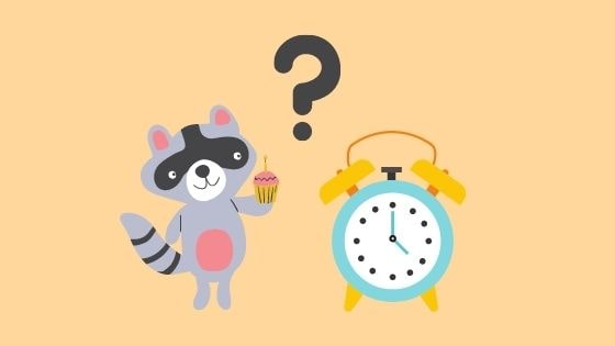 時間を確認する狸のイラスト